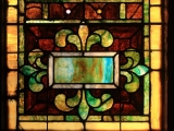 Small art glass window in need of restoration at St. Paul AME Church in Raleigh